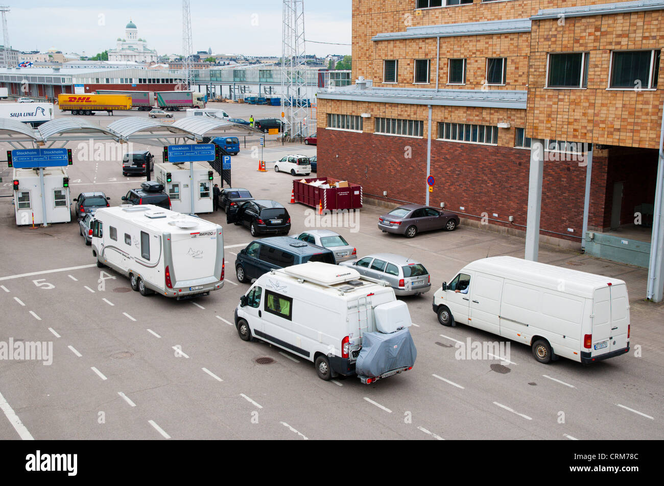 Vehicles moving towards ferry to Stockholm at Olympiaterminaali ferry terminal Eteläranta area central Helsinki - Stock Image
