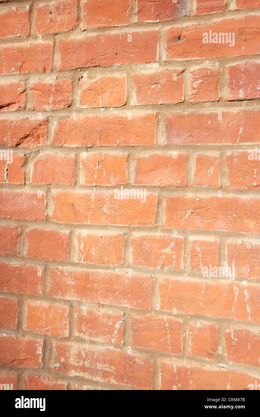 Close-up of reddish-brown brick wall - Stock Image