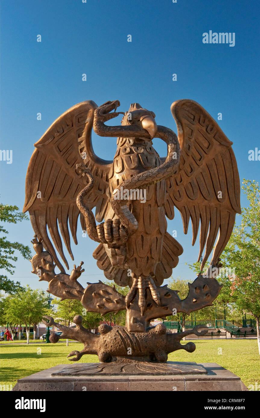 Mexican Golden Eagle national coat of arms and seal, sculpture on Plaza de la Republica in Reynosa, Rio Grande Valley, - Stock Image