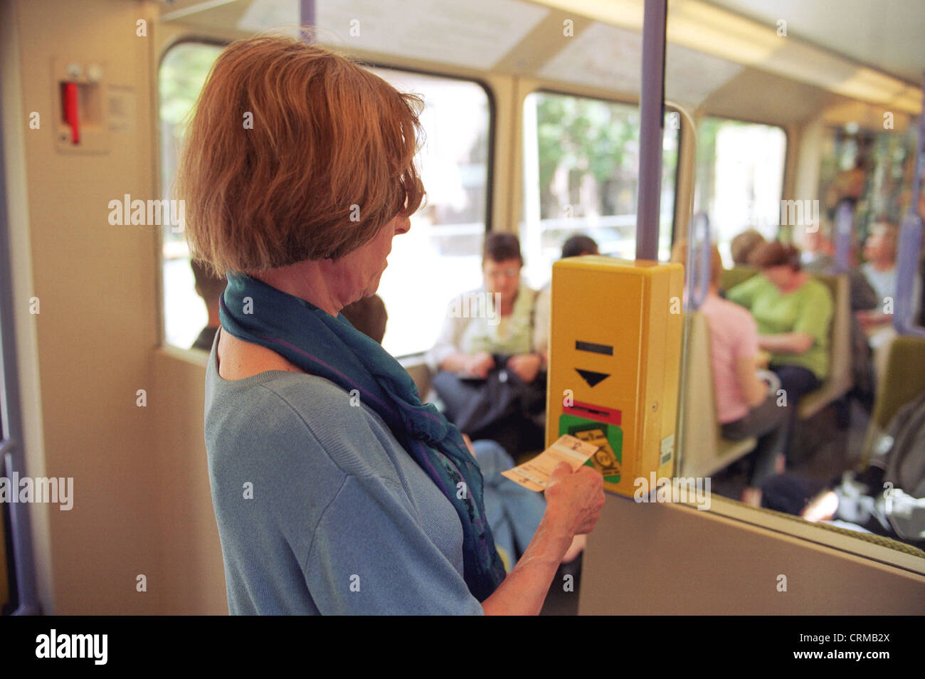 A woman tied a ticket - Stock Image