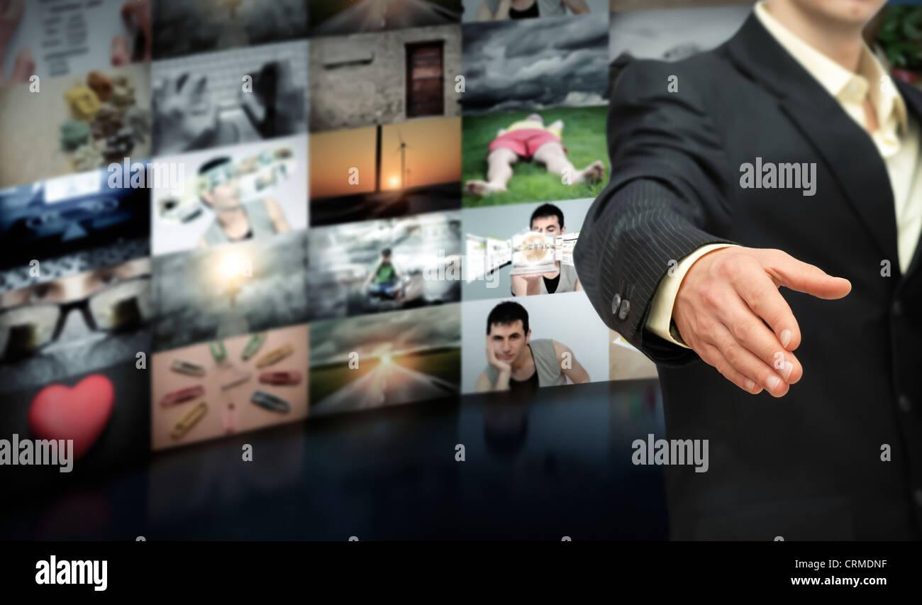 Businessman closing a multimedia deal - Stock Image