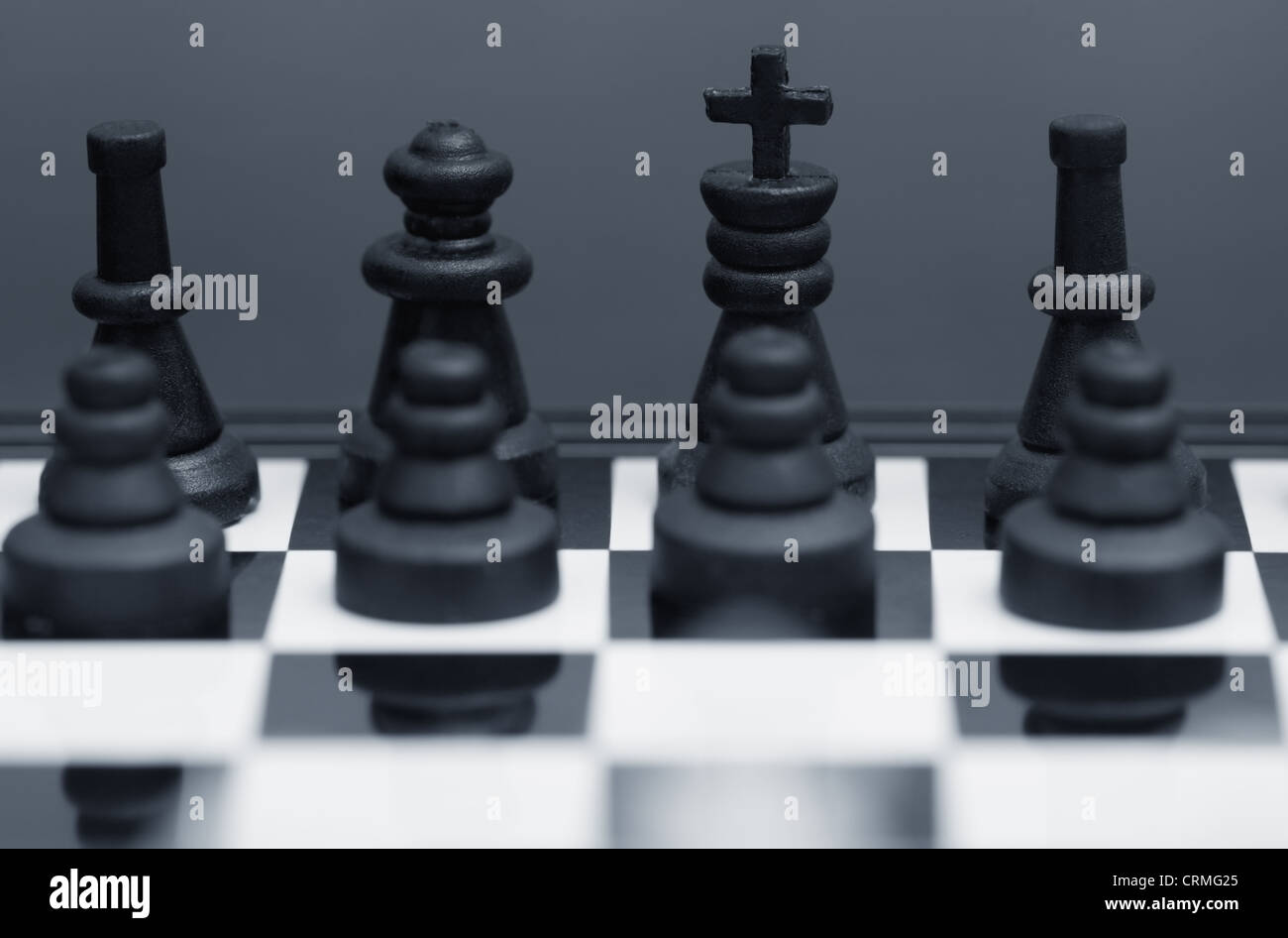 Close-up photo of the chessmen on a chessboard - Stock Image