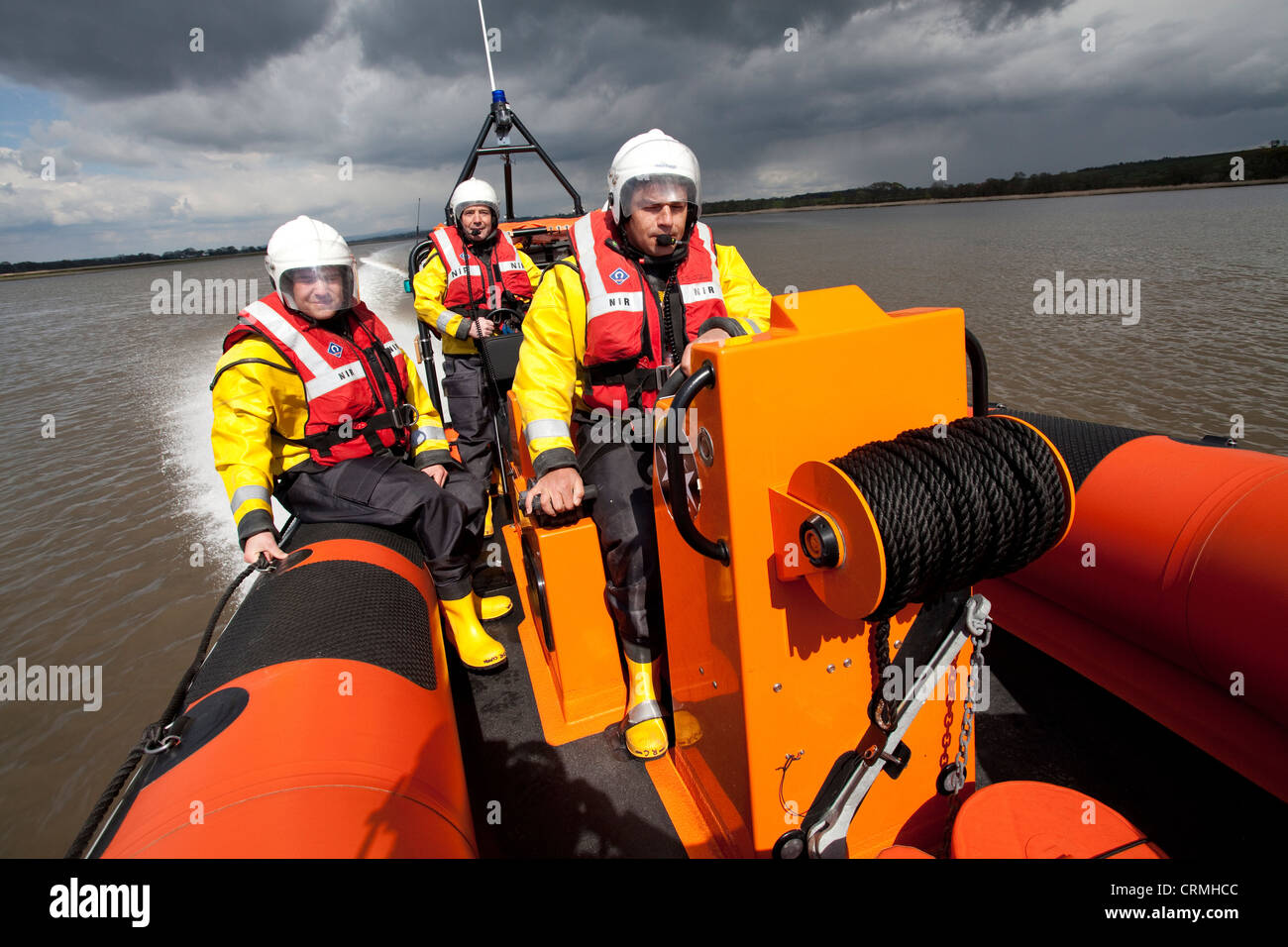 Brave men Nith Inshore Rescue independent lifeboat practising just of Glencaple in the River Nith Estuary, Solway - Stock Image