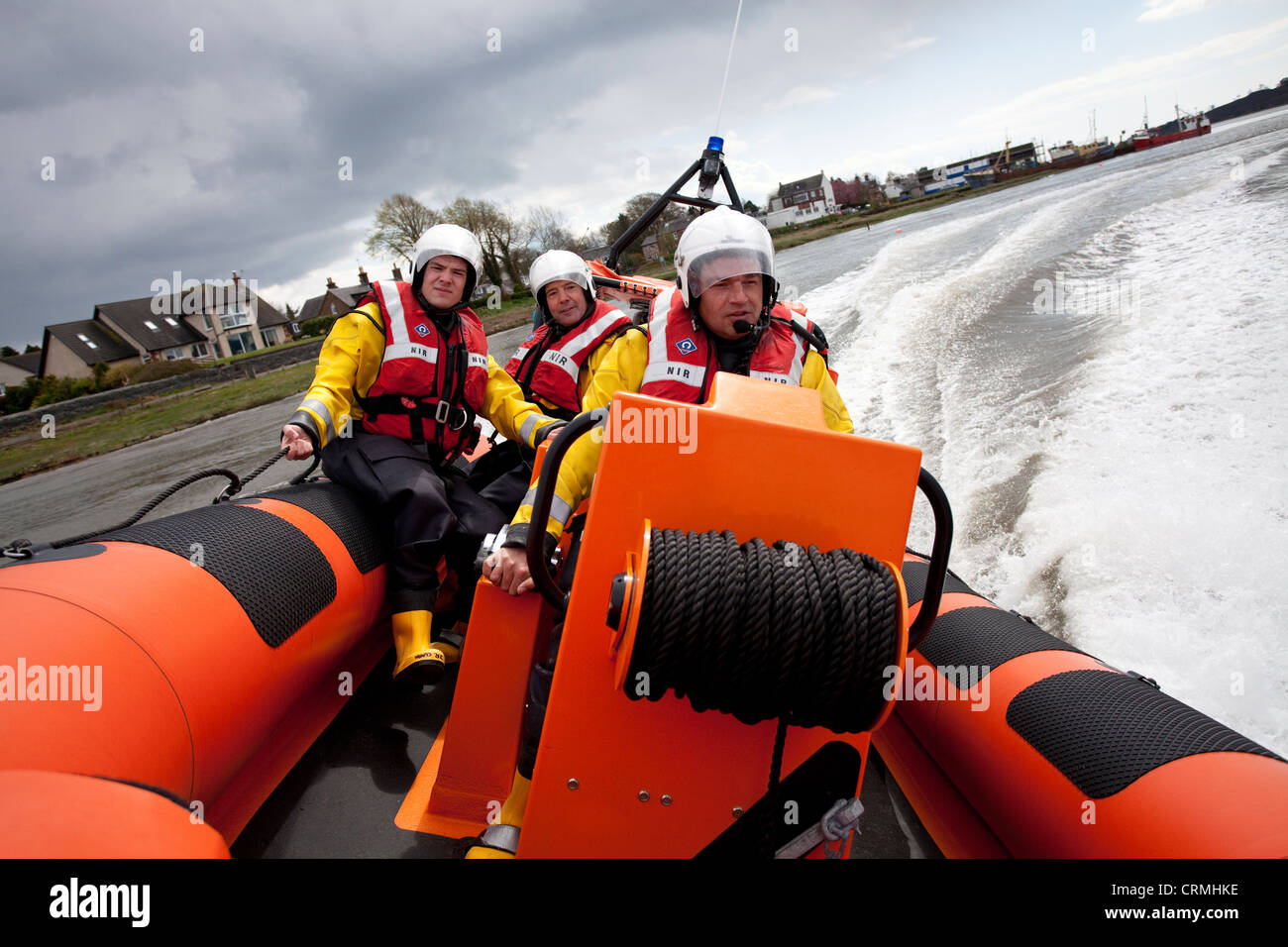 Brave men,Nith Inshore Rescue independent lifeboat practising just of Glencaple in the River Nith Estuary near Dumfries - Stock Image