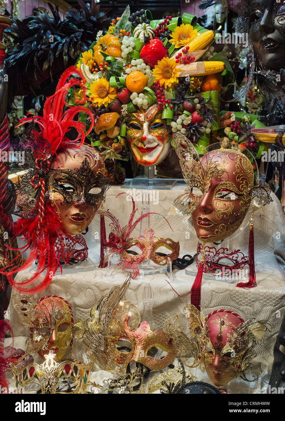 A shop window display of Venetian Carnival masks. - Stock Image