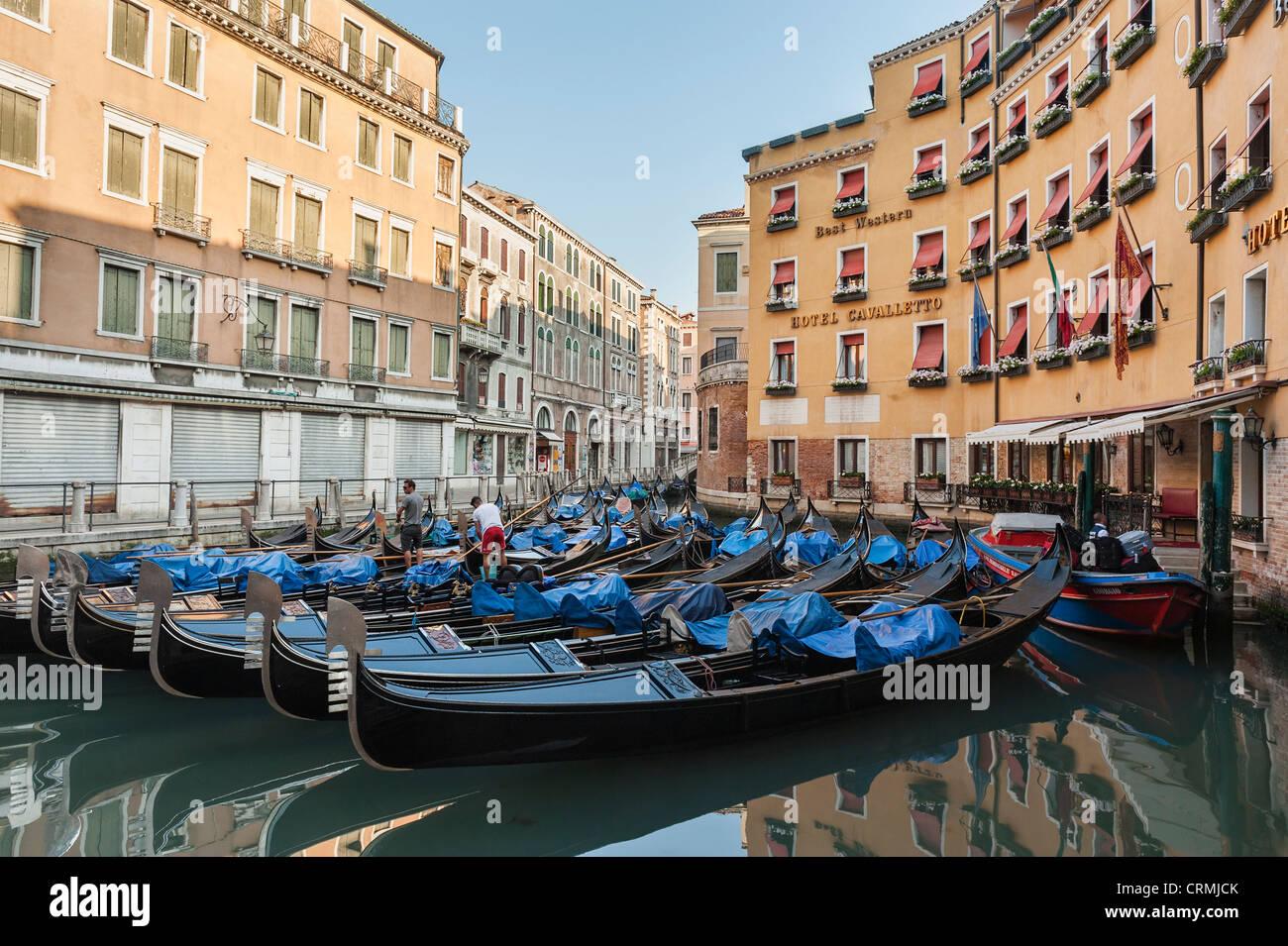 Gondola moorings in Bacino Orseolo Venice. - Stock Image