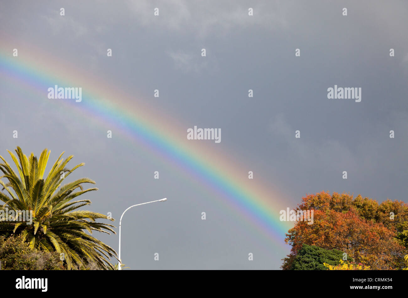 Rainbow over Central Otago, New Zealand - Stock Image