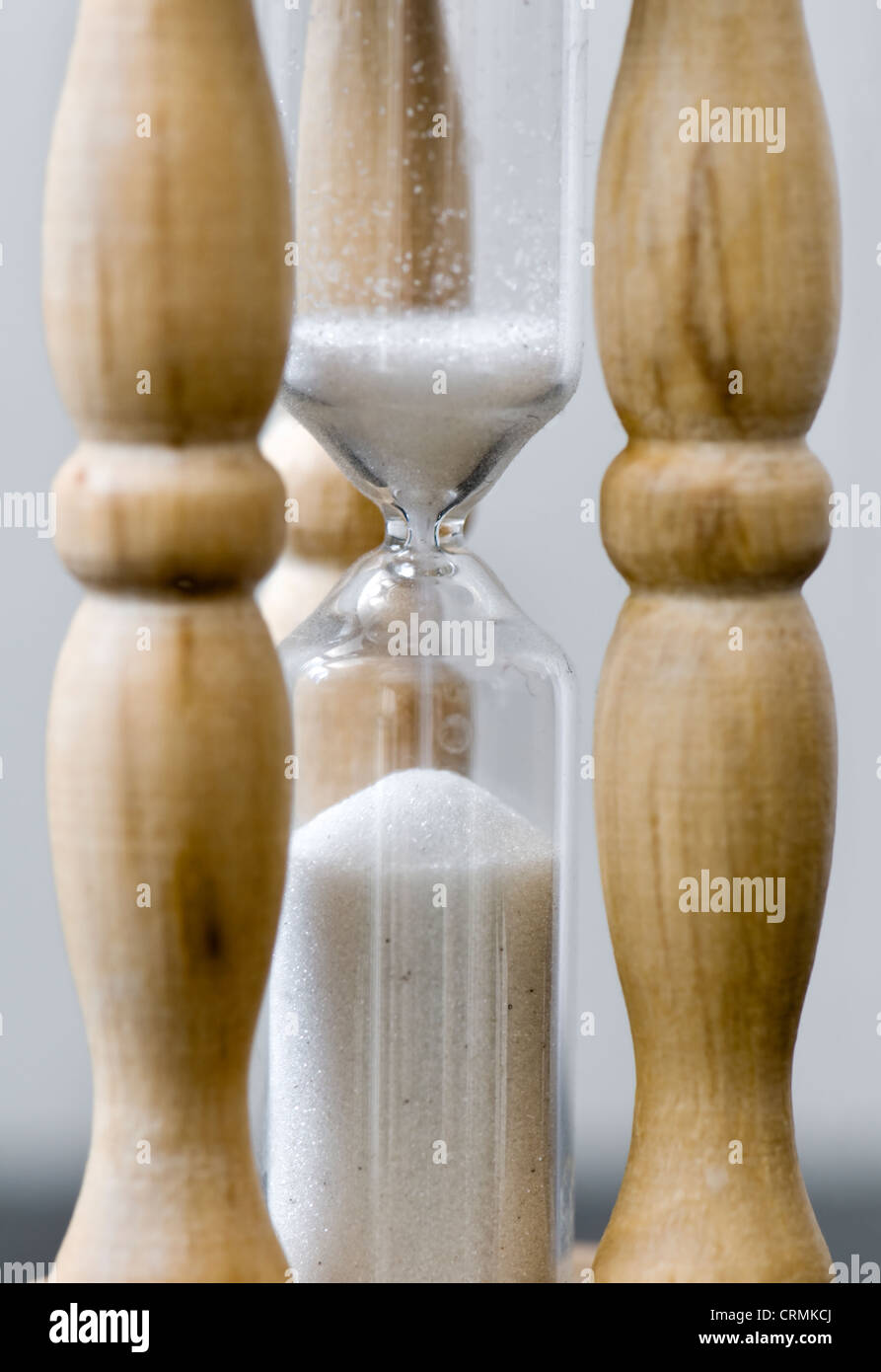 Close up of egg timer or kitchen timer with sand or grains running out, concept of time running out or time is up - Stock Image