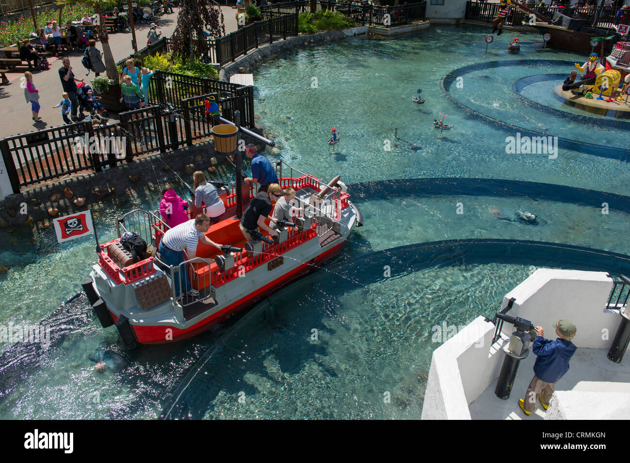Water fights aboard Lego boats at Pirateland with skull gateway, Legoland, Billund, Denmark - Stock Image