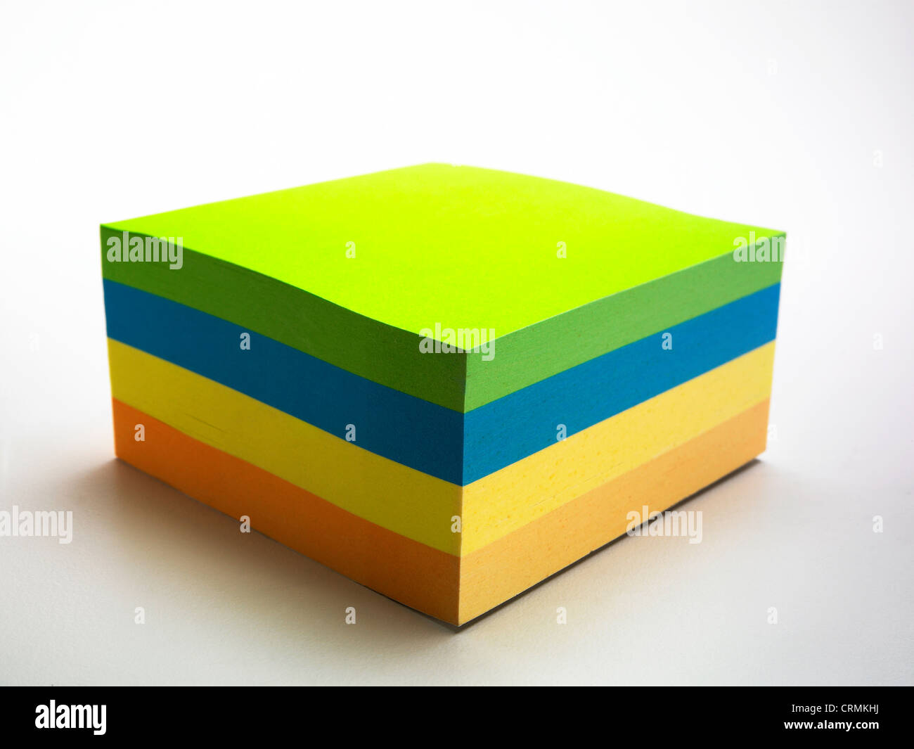 A block of coloured sticky notes - Stock Image