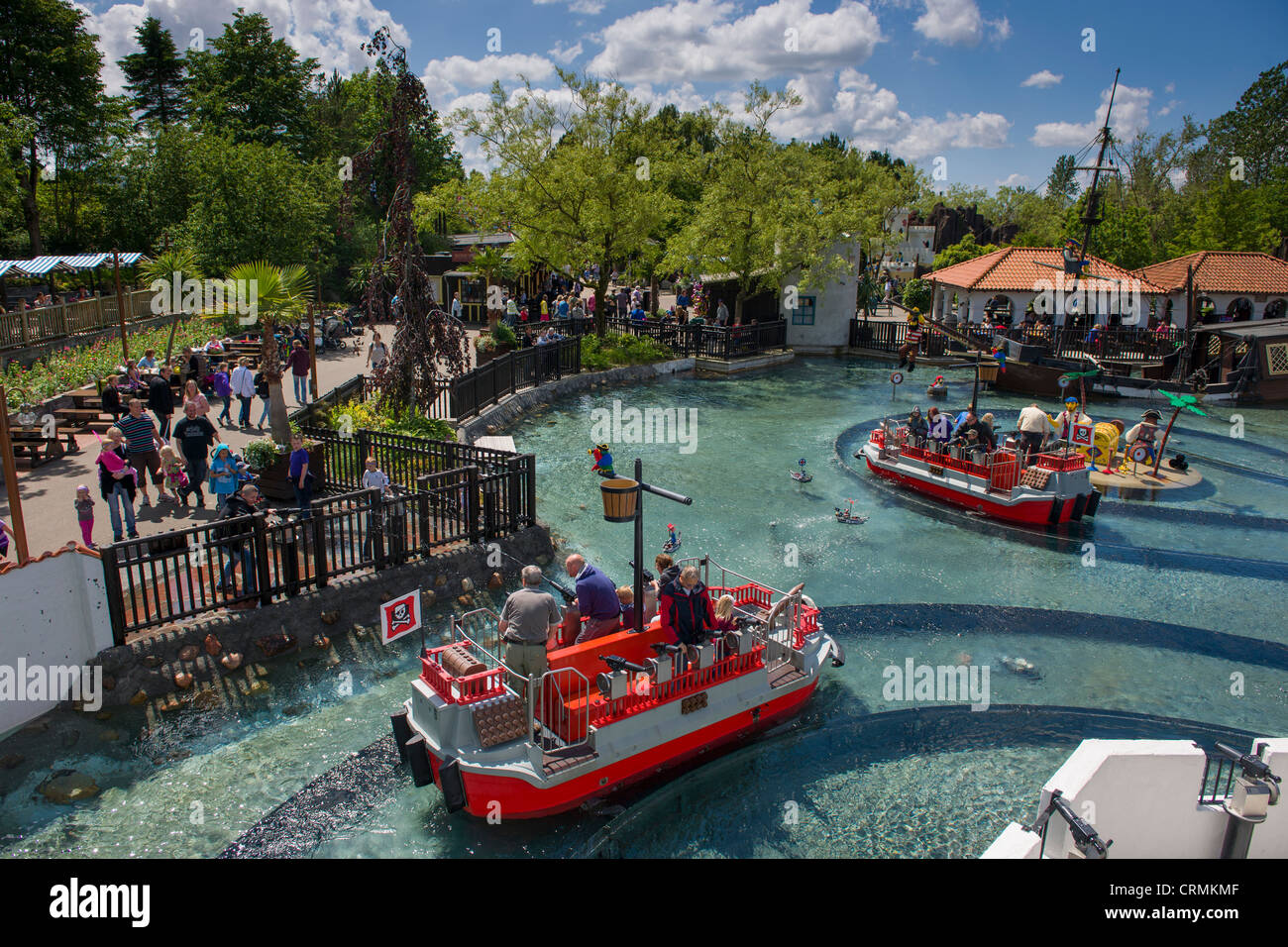 Water fights aboard Lego boats at Pirateland, Legoland, Billund, Denmark - Stock Image