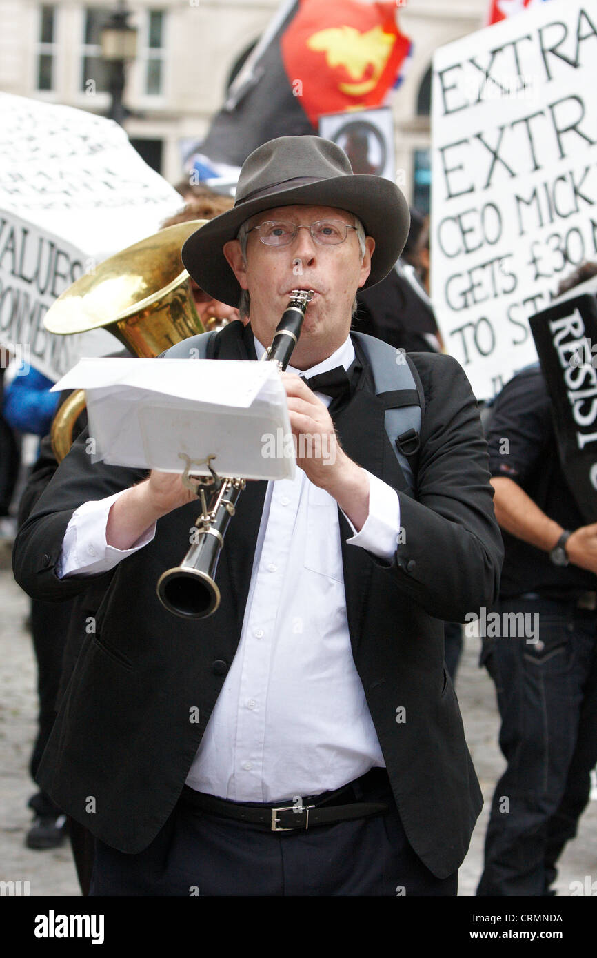 Jazz band member plays during the Carnival of Dirt protest against mining companies in London Stock Photo