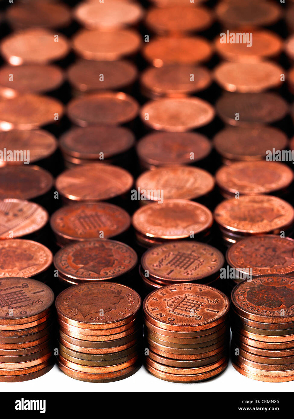 Neat piles of British pennies - Stock Image