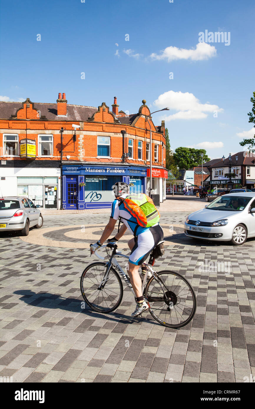 Poynton village in Cheshire uses a shared space where pedestrians and motorists share the space. - Stock Image