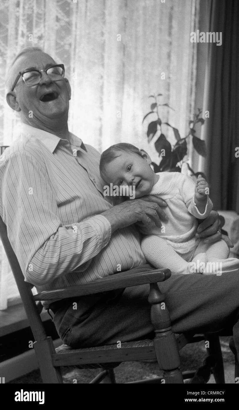 Fabulous Black White Shot Happy Grandpa Holding Baby In Rocking Squirreltailoven Fun Painted Chair Ideas Images Squirreltailovenorg