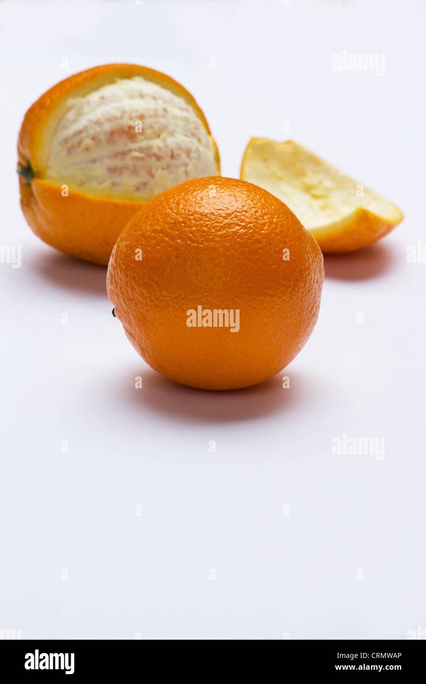Fresh oranges (Citrus sinensis)on white background - Stock Image