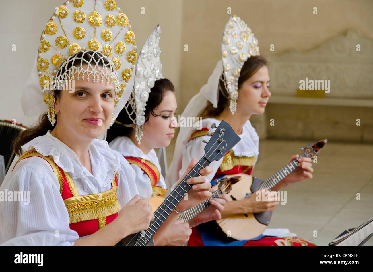 Ukraine, Yalta, Livadia Palace. Ukrainian folkloric show. Women in traditional costumes playing Russian balalaikas Stock Photo