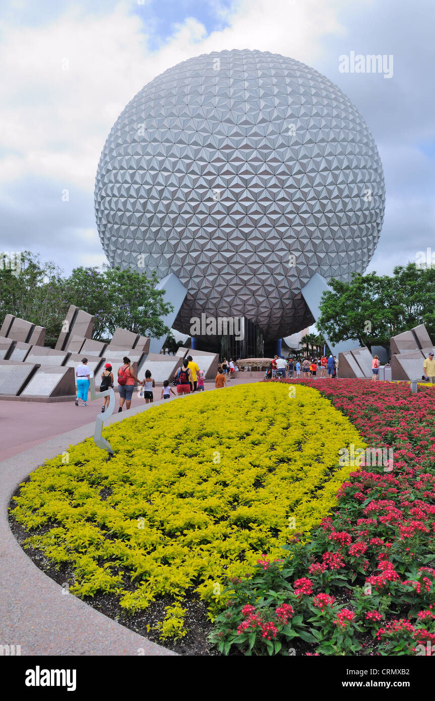 The Epcot polyhedron is the backdrop for a colourful bedding plant display. - Stock Image