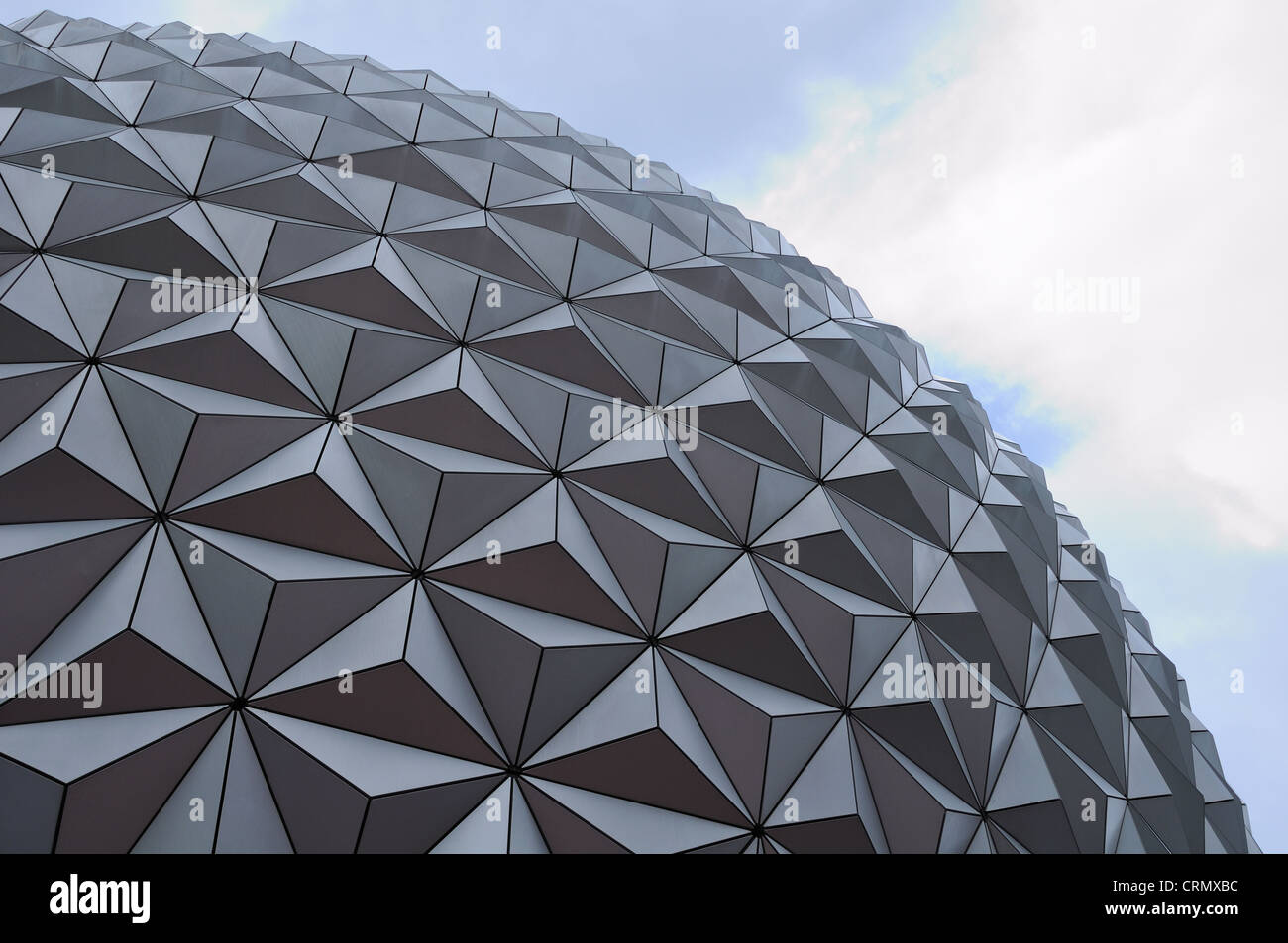 The Epcot polyhedron isolated against a cloudy blue sky. - Stock Image
