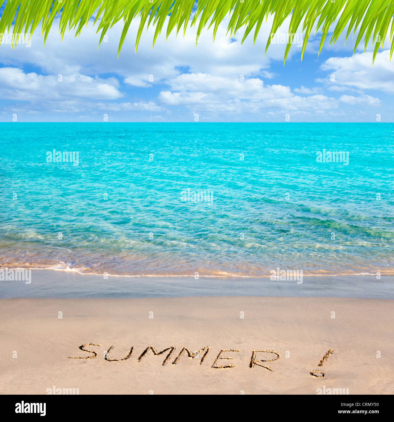Caribbean tropical beach with Summer word written in sand - Stock Image