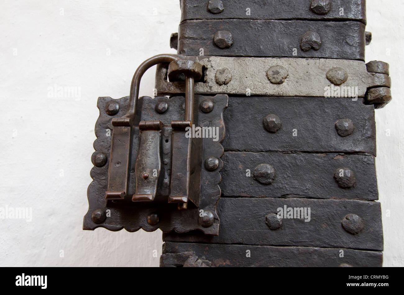 Denmark, Helsingoer. Helsingoer Domkirke St. Olai (aka Helsingoer Cathedral), old iron padlock. - Stock Image
