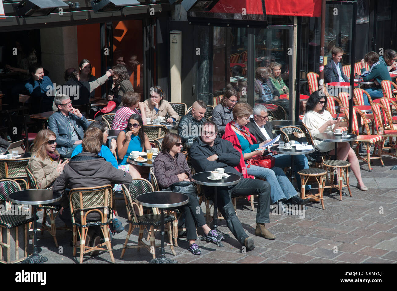 Parisians seated outside a cafe on the Left Bank - Stock Image