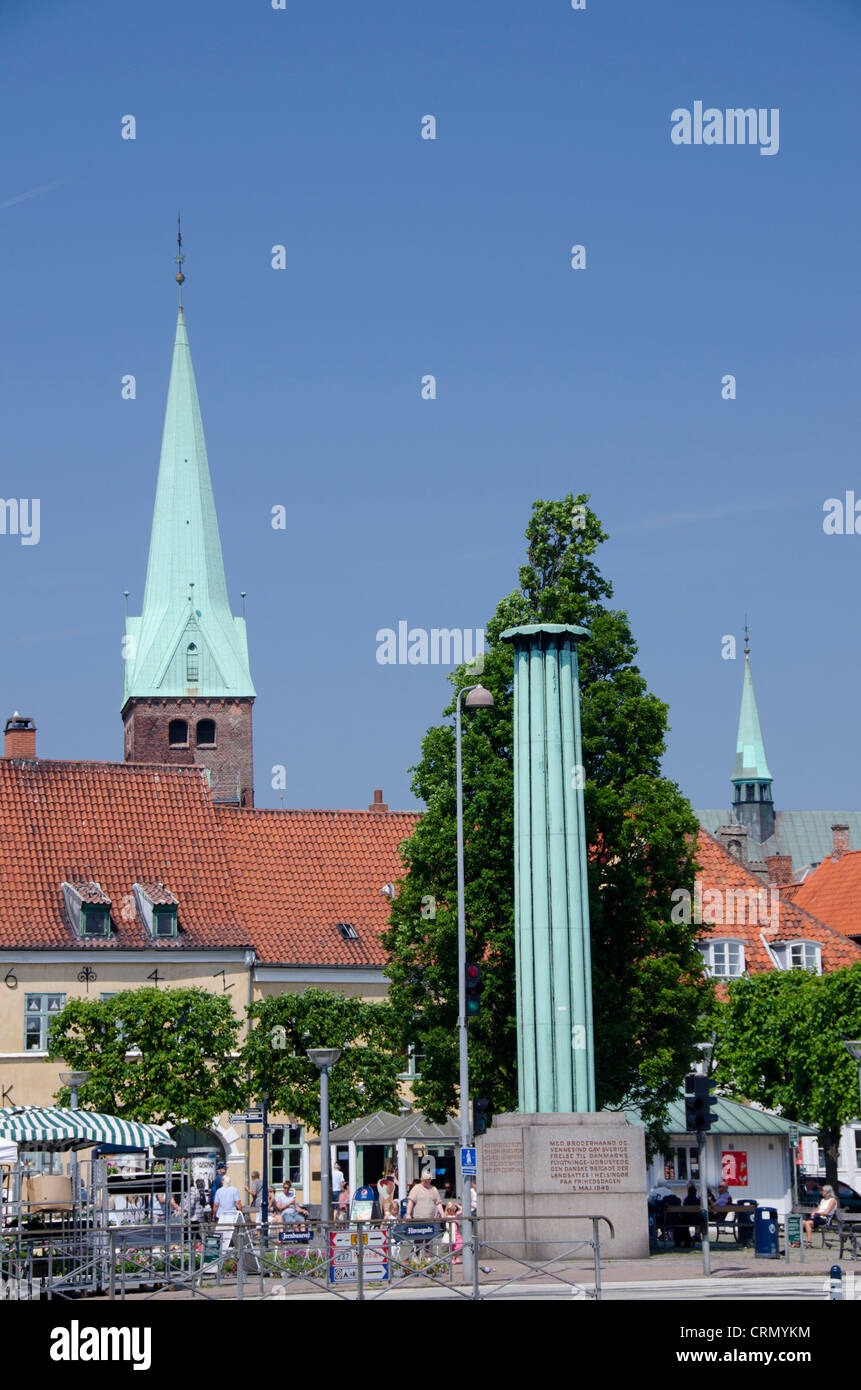 Denmark, Helsingoer. Downtown view with historic church steeple and column. - Stock Image