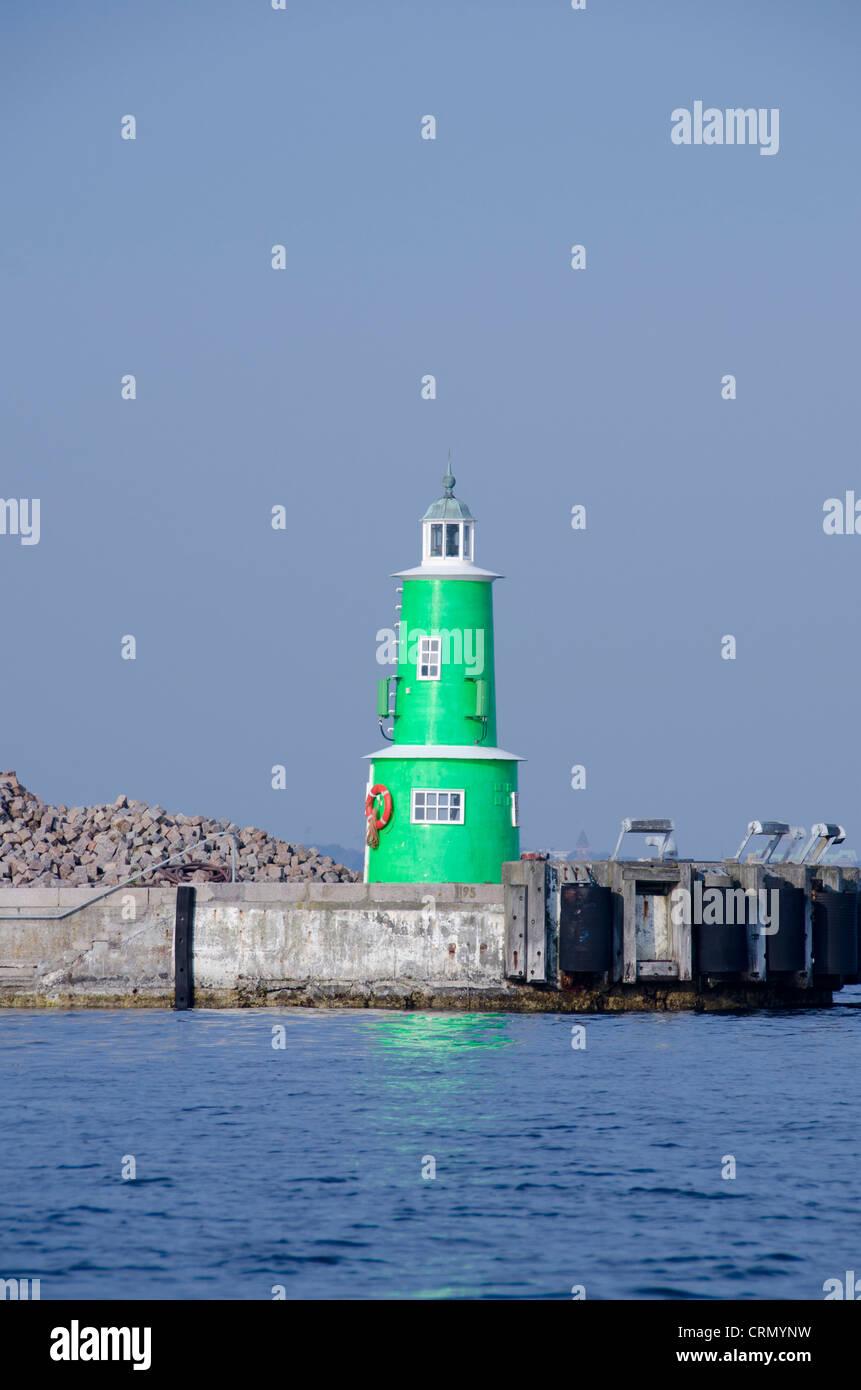 Denmark, Helsingoer. Brightly colored North Sea port lighthouse. - Stock Image