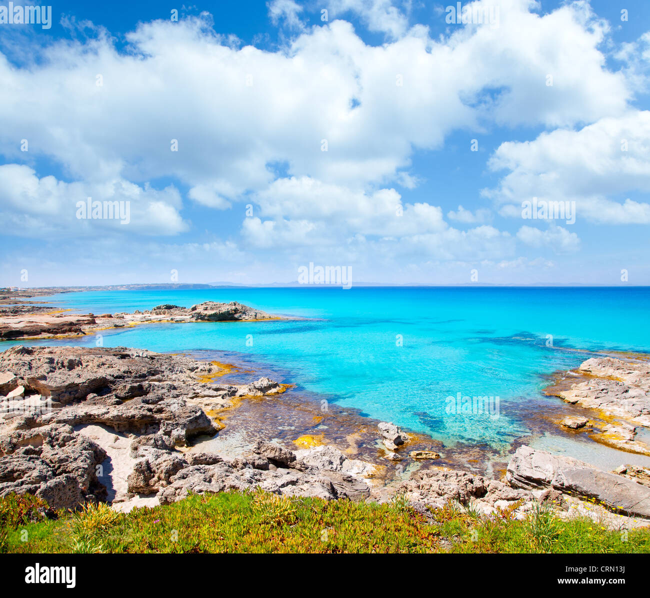 Balearic formentera island in escalo rocky beach and turquoise sea - Stock Image