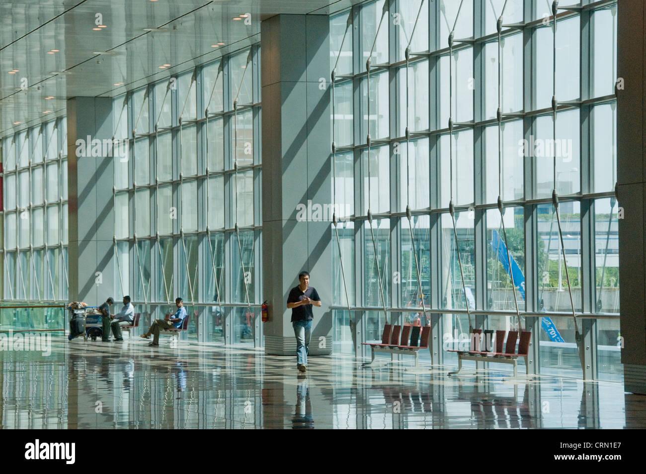 Glass atrium lobby Interior of new modern Changi airport terminal in Singapore southeast Asia - Stock Image