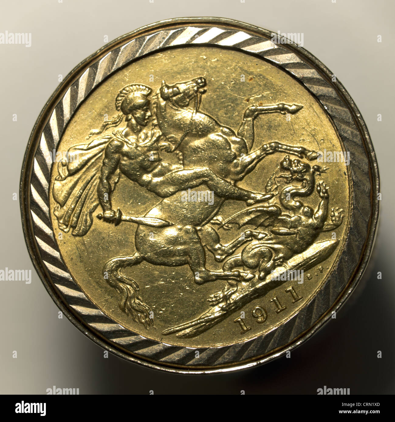 A 1911 gold sovereign in a mount used as a man's ring with an image of St George on horseback slaying the dragonStock Photo