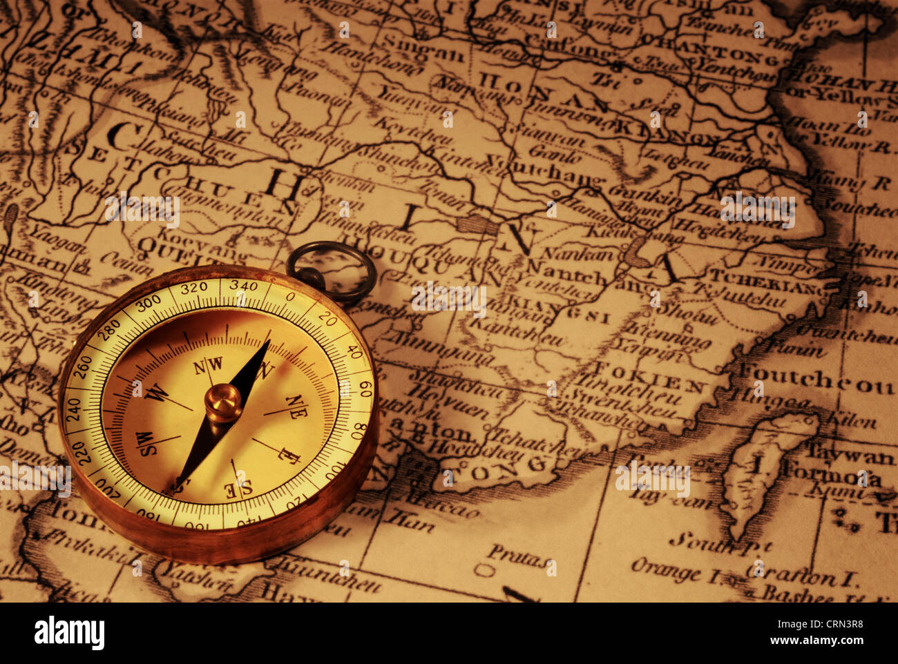 Grungy old compass and ancient map of china which is from 1799 and grungy old compass and ancient map of china which is from 1799 and out of copyright gumiabroncs Gallery