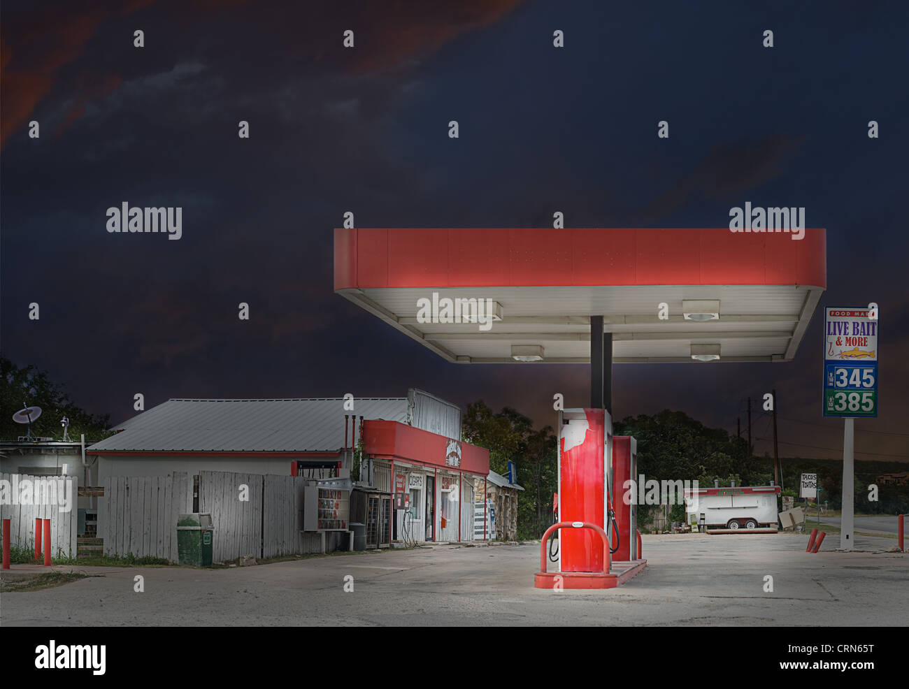 Country Store and Gasoline Station at Dusk Stock Photo