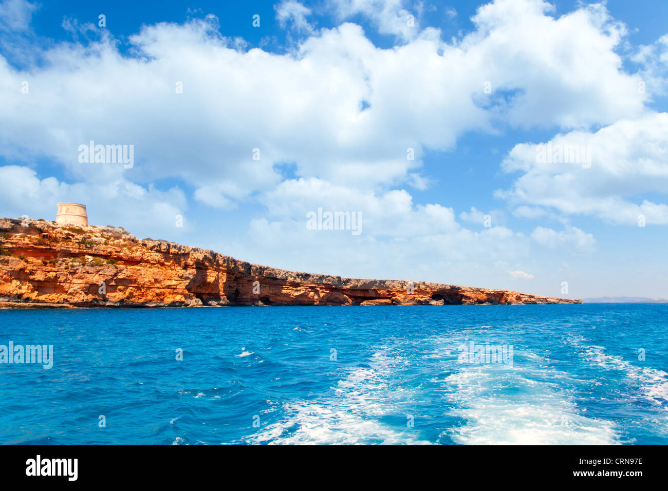 Formentera Raco des Forat with round tower view from sea boat - Stock Image
