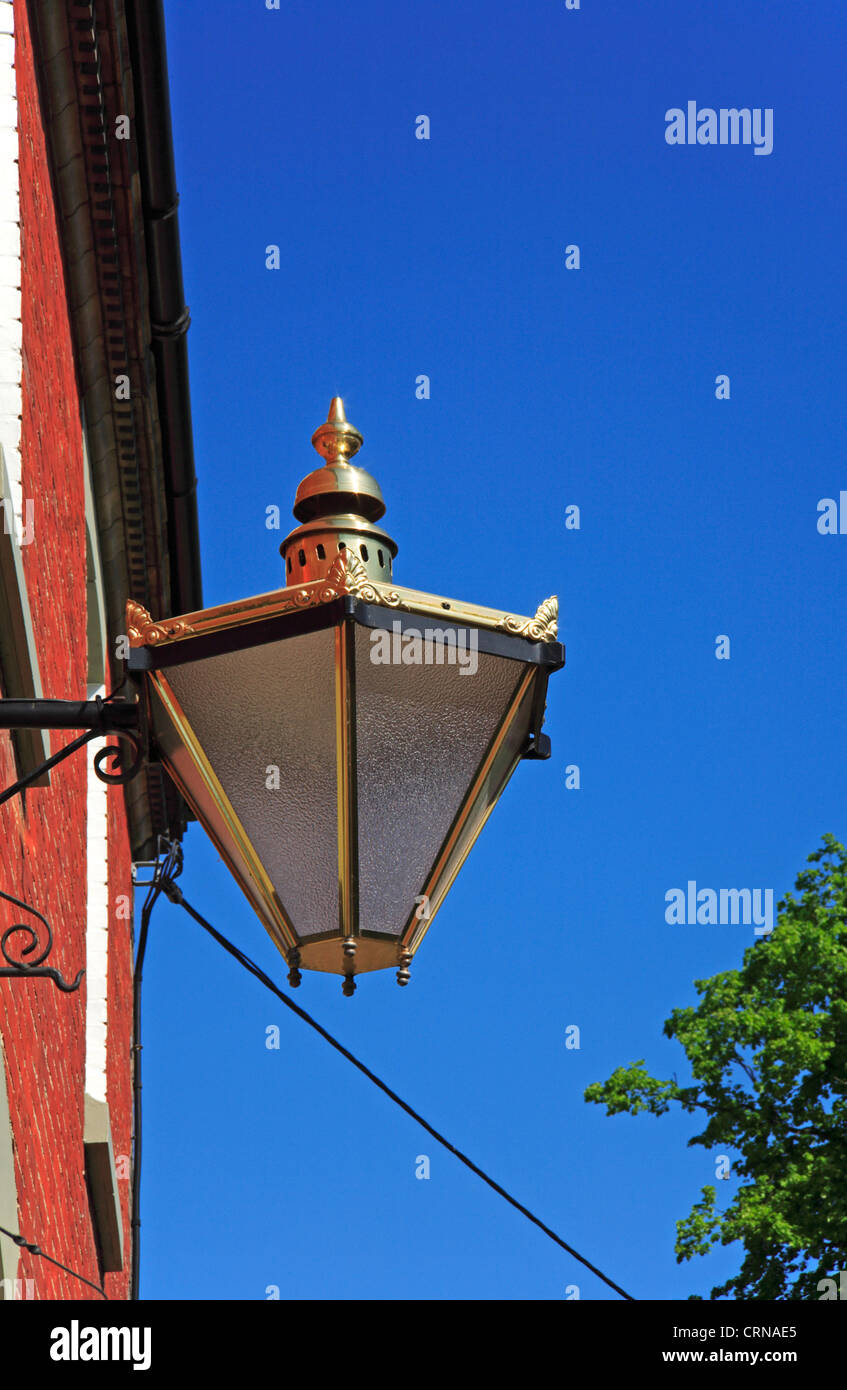 A close-up view of an ornate outside lamp on a Georgian style building at New Buckenham, Norfolk, England, United - Stock Image