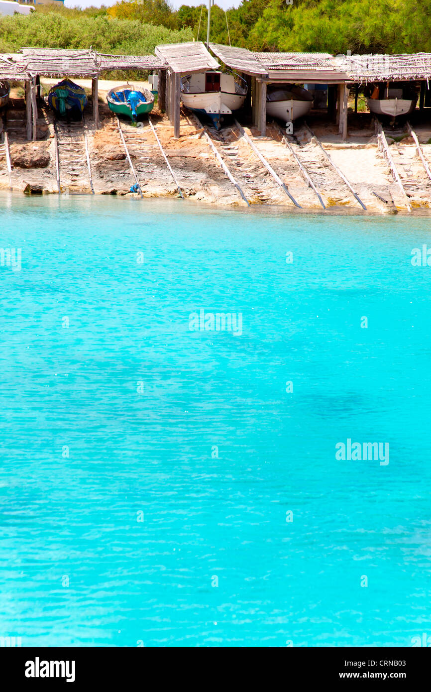 Es Calo de San Agusti port in Formentera island beached boats with wood rails - Stock Image