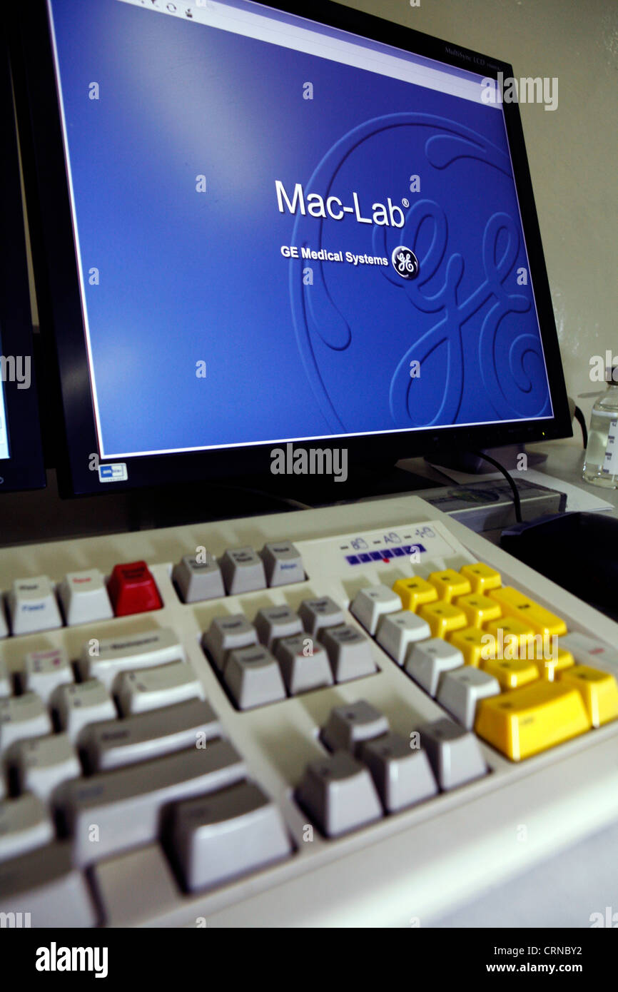Computer keyboard and computer screen displaying Mac-Lab and GE Medical Systems logo. - Stock Image