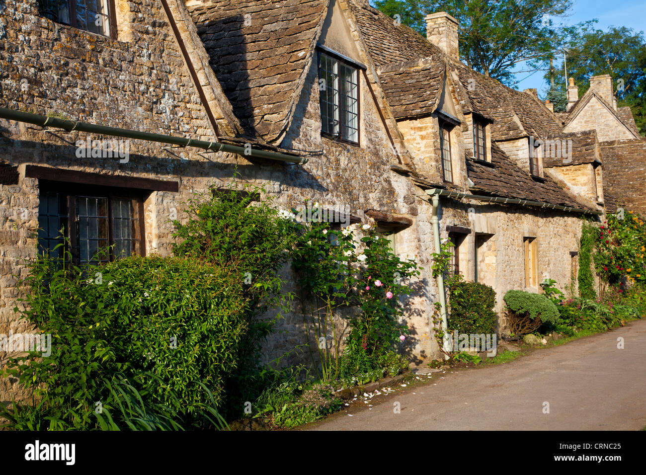 Famous row of weavers cottages,Arlington Row,built in 1380 as a monastic wool store. Bibury Cotswolds Gloucestershire - Stock Image