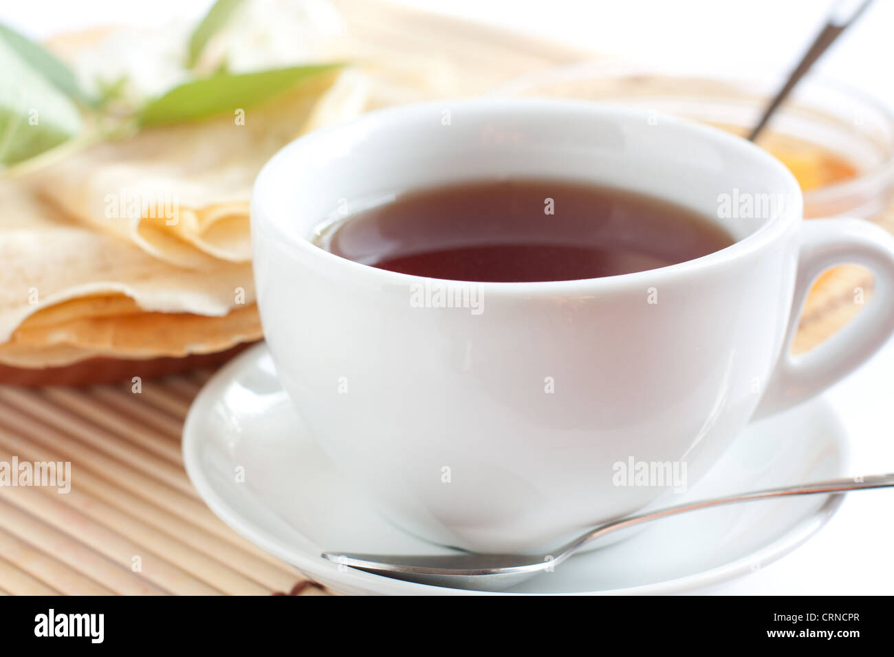 White cup of fragrant tea. Strong black tea - Stock Image