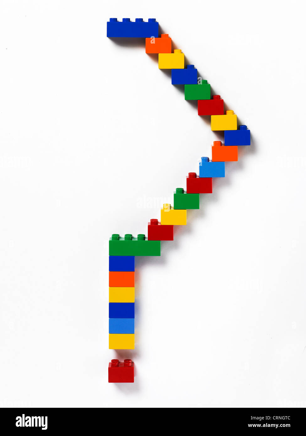 Coloured plastic building bricks in the shape of a question mark - Stock Image
