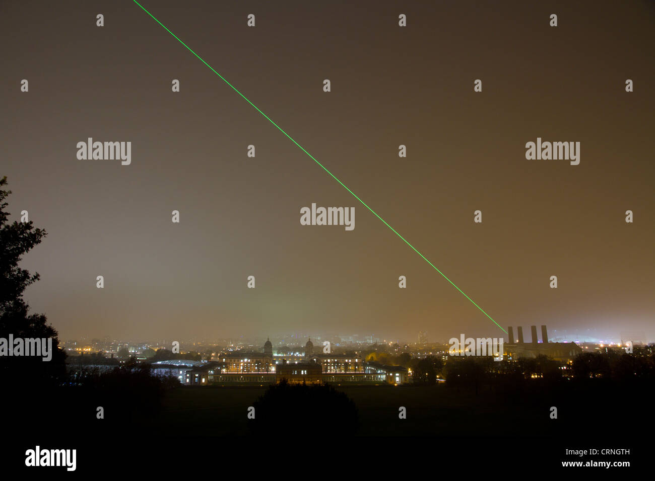 Laser being projected from the Royal Observatory at Greenwich across the London skyline marking the Prime Meridian - Stock Image