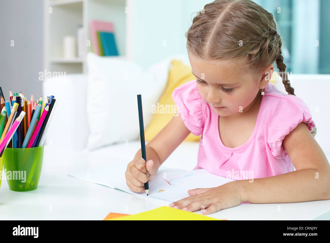 cute little girl drawing with crayons stock photo 49033207 alamy