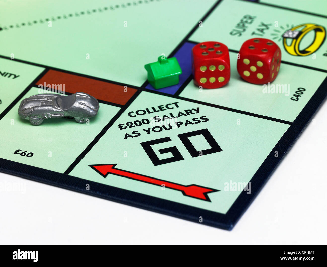 A Monopoly game board showing Go - Stock Image