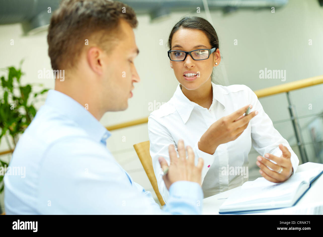 Disagreement occurring in the midst of the discussion between two business people Stock Photo