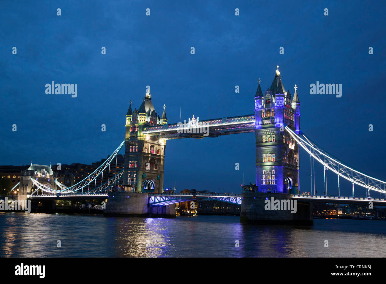 Illuminated Tower Bridge and the River Thames with colourful lighting display Stock Photo