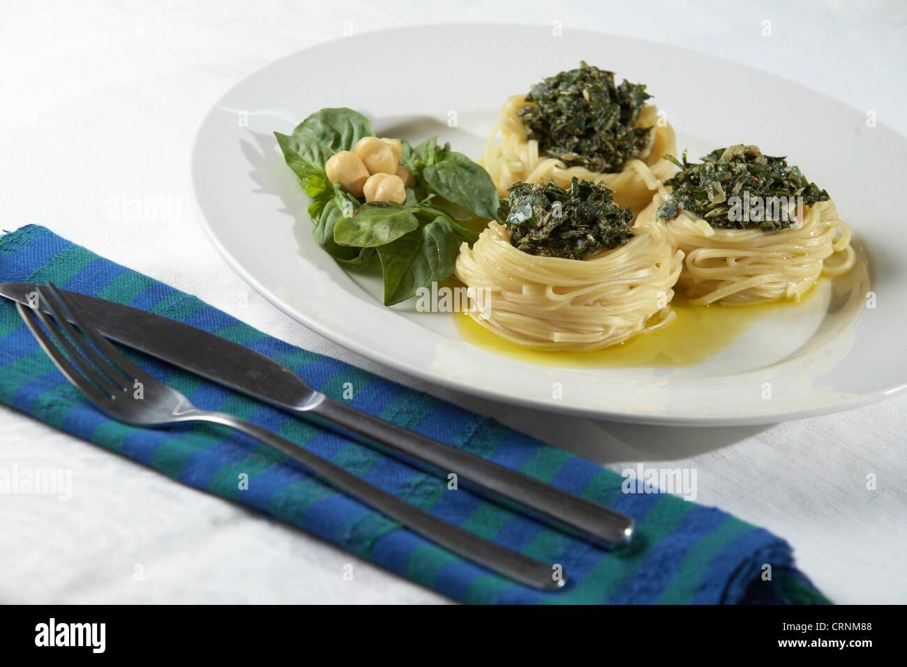 Pesto pasta with macadamia nuts. - Stock Image