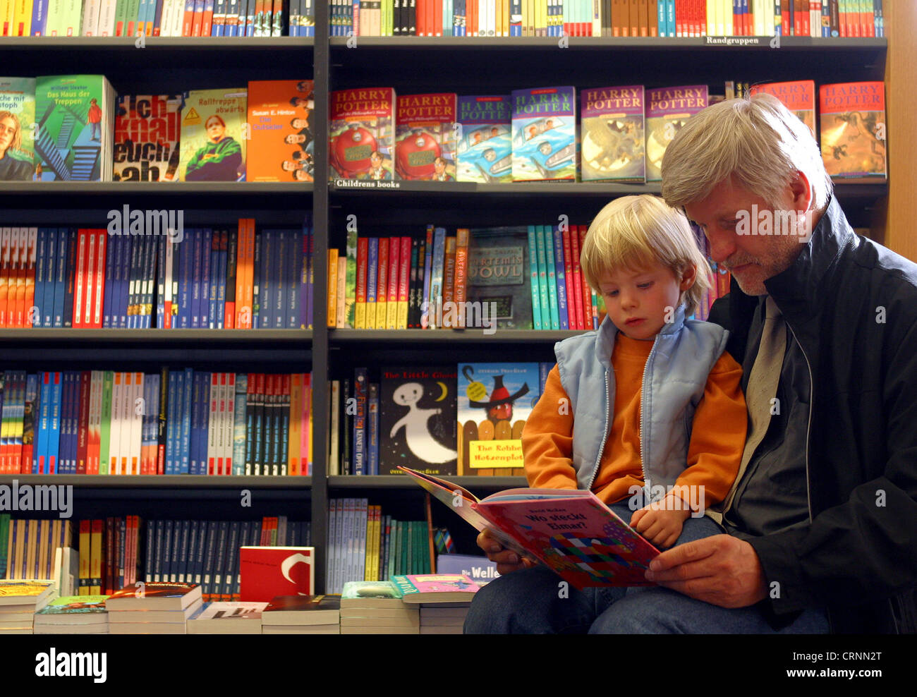 Father - Son - Reading - Bookstore in Food Stock Photo