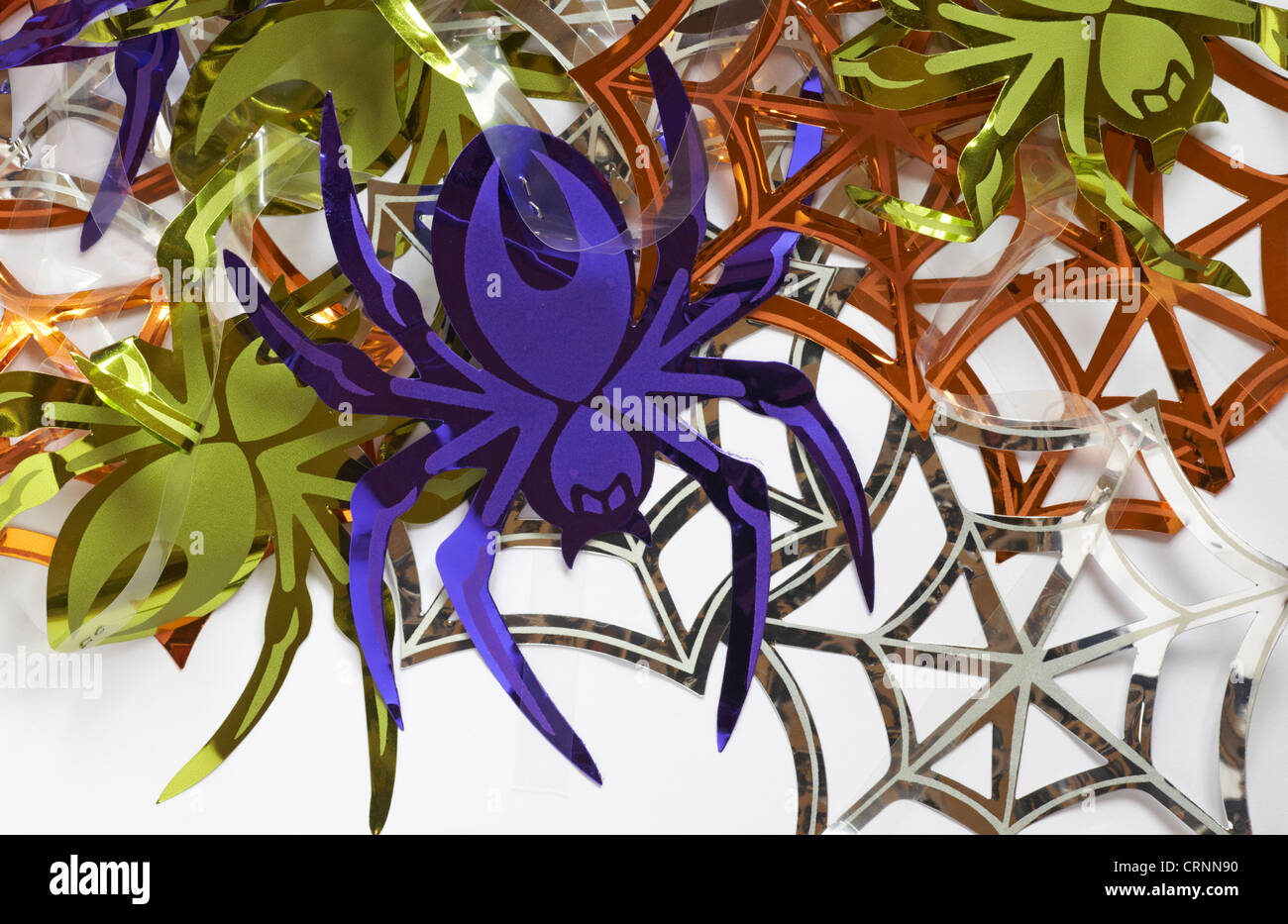 shiny spiders and spider webs decorations for halloween set on white background - Stock Image