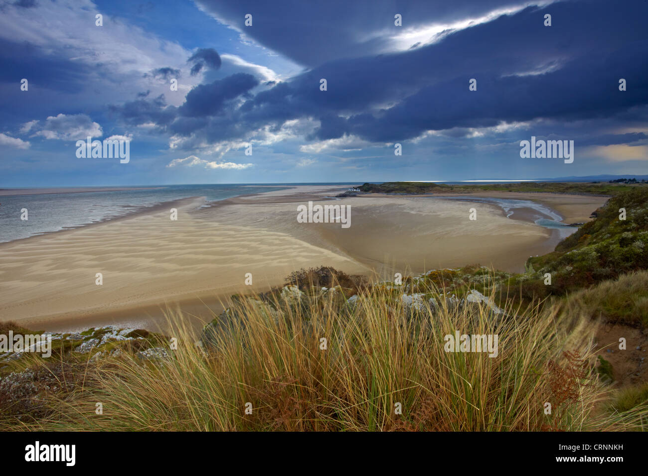 View of the sandy tidal estuary of the Afon Glaswyn looking towards Tremadog Bay with the building known as the Stock Photo