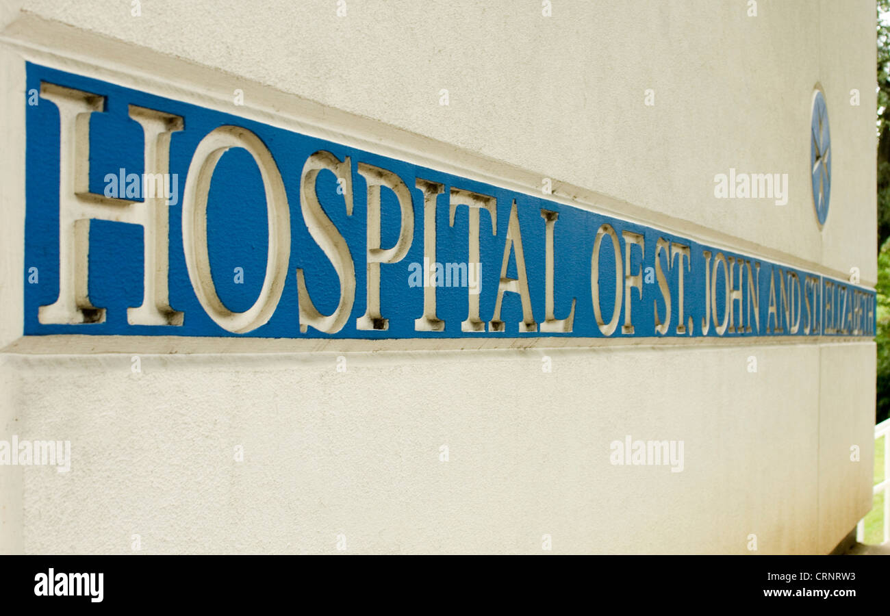 The blue and gold sign of the hospital of St John and St Elizabeth, London, England - Stock Image